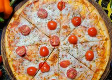 Pizza fast eating junk food italian meal. Pizza with cheese and tomatoes. Junk food , over eating and fast eating concept. Italian famous meal Royalty Free Stock Photos