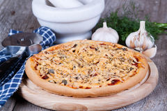 Pizza with cheese. On a wooden board Stock Photo