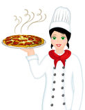 Pizza chef. A pretty woman chef carrying a pizza Stock Image
