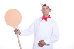 Pizza chef showing his shovel. Pizza chef showing his wooden shovel Stock Photography