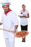 Pizza chef and a waitress Royalty Free Stock Photo