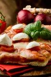 Pizza with Cherry Tomatoes and Buffalo Mozzarella Royalty Free Stock Photo