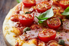 Pizza with cherry tomatoes and ham Royalty Free Stock Photos