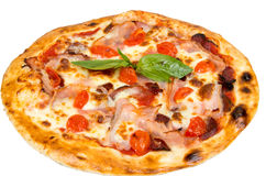 Pizza with cherry tomatoes, meat and cheese. Royalty Free Stock Image