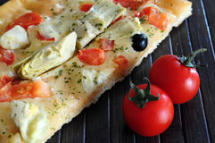 Pizza with cherry tomatoes Stock Photography