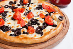 Pizza Cherry on a wood plate Royalty Free Stock Photos