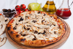 Pizza Chicken. Pizza with chicken, mushrooms and olive and oil stock photography