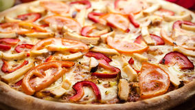 Pizza chicken in the increase. Pizza with chicken meat and tomatoes to increase Royalty Free Stock Images