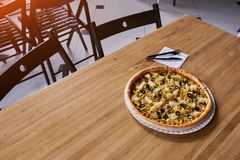 Pizza with chicken and pineapple on the table in the restaurant stock images