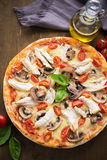Pizza with chicken, tomato and mushrooms Stock Photo