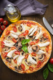 Pizza with chicken, tomato and mushrooms Stock Image
