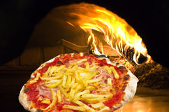 Pizza chips in a pizza oven stock images