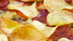 Pizza with chips and salami closeup stock footage