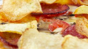 Pizza with chips and salami rotates stock footage