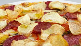 Pizza with chips and salami stock video