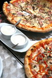 Pizza choice. Funghi and pepperoni pizzas with a garlic sauce Royalty Free Stock Image