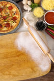 Pizza background, chopping board, ingredients, copy space, vertical Royalty Free Stock Photo