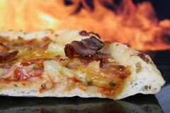 Pizza by clay oven, closeup with copy space Royalty Free Stock Photo
