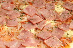 Pizza close up. Pizza with ham and cheese close up Stock Photography