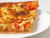 Pizza close up. Fresh homemade pizza with pork, tomatoes, pepper, soft cheese etc Royalty Free Stock Image