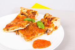 Pizza closeup. Homemade pizza closeup on a white plate Royalty Free Stock Images