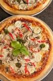 Pizza cocinada Fotografía de archivo libre de regalías