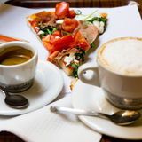 Pizza, coffee and cappuccino. Pizza, cup of coffee and cup of cappuccino Stock Photos