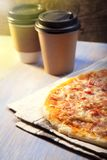 Pizza and Coffee on wooden table, cup of cappuccino. stock photography