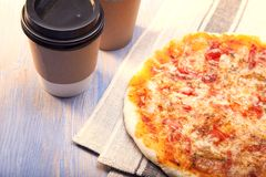 Pizza and Coffee on wooden table, cup of cappuccino. Stock Image