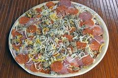 Pizza con los desmoches del cerdo Fotos de archivo