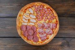Pizza con quattro generi di carne Fotografia Stock