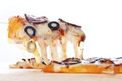 Pizza con queso derretido Imagen de archivo libre de regalías