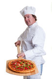 Pizza Cook. A chef holding a pizza on a peel on a white background Stock Images