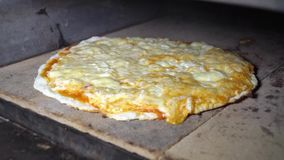 Pizza is cooked in the oven stock video