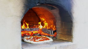 Pizza cooked in a wood oven stock footage