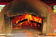 Pizza cooking in an oven Royalty Free Stock Image
