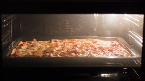 Pizza cooking in oven. time-lapse video stock video footage