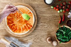 Pizza cooking process royalty free stock photography