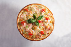 Pizza with crab, shrimp, cherry tomatoes and basil Stock Image