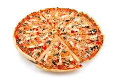 Pizza with the cut off slice Royalty Free Stock Photography