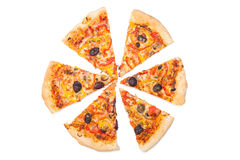 Pizza cut into slices Royalty Free Stock Images