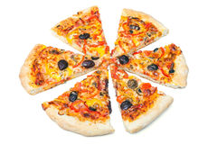 Pizza cut into slices Royalty Free Stock Photos