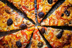 Pizza cut into slices Stock Photography