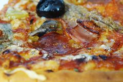 Free Pizza Cuts With Anchovies And Black Olives And Salami Royalty Free Stock Images - 107451409