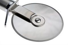 Pizza Cutter. Studio close-up wheel section of a stainless steel Pizza cutter Stock Image