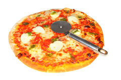 Pizza with cutter. Mozzarella cheese, tomato and pesto pizza on white with cutter Stock Image