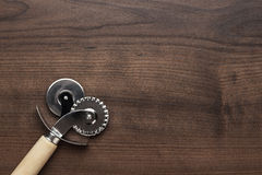 Pizza cutter on the wooden table Stock Photo