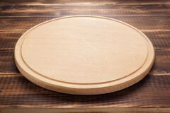 Free Pizza Cutting Board At Rustic Wooden Plank Background Stock Photos - 171330193