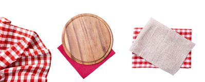 Pizza cutting board. Empty tablecloth set and wood plate isolated on white background. Selective focus. Place for food. Top view. royalty free stock photo