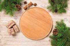 Pizza cutting board at table background with christmas decoration, Round board. New Year concept.  royalty free stock photography
